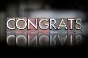The word Congrats written in vintage letterpress type